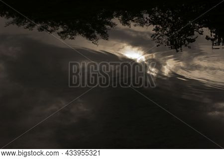 Mirroring Clouds And Sky In A Pond