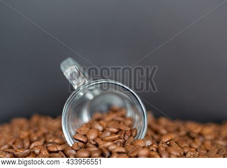 Closeup Of A Cup Of Coffee With Roasted Dark Brown Coffee Beans