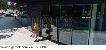 Happiness, Consumerism, Sale And People Concept - Smiling Young Woman With Shopping Bags Over Mall B