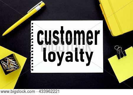 Customer Loyalty .notepad On Black Background .near Yellow Stickers