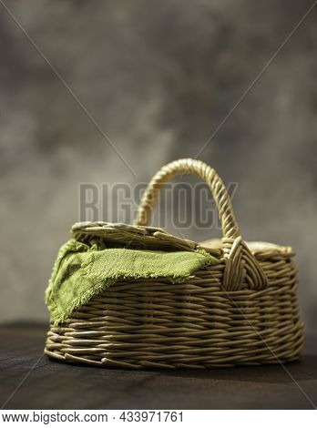 Basket With Green Napkin Picnic On Table Place. Natural Eco Materials. Zero West.