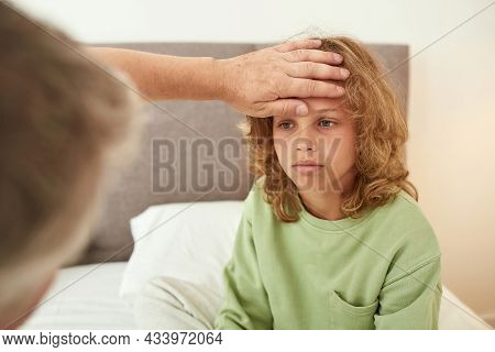 Loving Parent Measure High Temperature Of Sick Unhappy Teen Boy Child Feel Unhealthy On Quarantine A