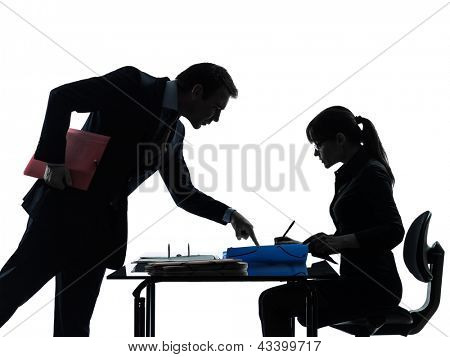 one caucasian business woman man couple  in silhouette studio isolated on white background
