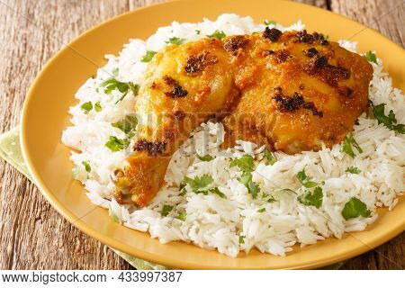 Roasted Spiced Ayam Percik Chicken With Rice Close Up In The Plate On The Table. Horizontal
