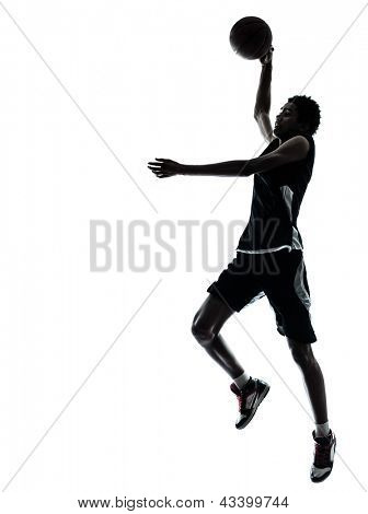 one young man basketball player silhouette in studio isolated on white background
