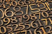 number abstract -  a variety of letterpress wood type printing blocks poster