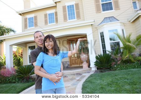 Attractive Diverse Couple At Home