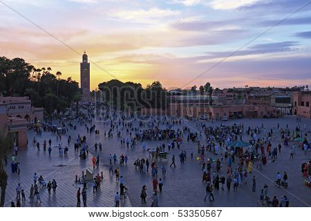 Sunset at Djemaa el Fna market in Marrakesh, Morocco, with Koutubia Mosque at the back poster