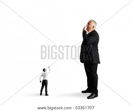 small man showing fist to big bored businessman. isolated on white background