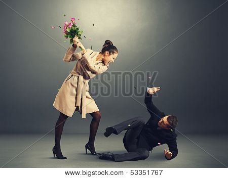 young woman yelling at frightened man