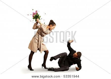 young angry woman screaming at startled man. isolated on white background