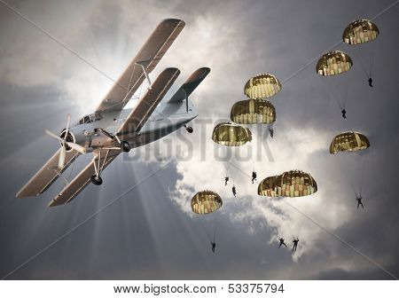 Retro style picture of the biplane with skydivers.