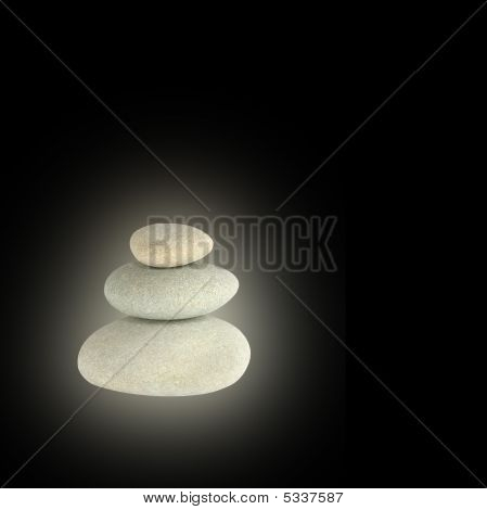 Glowing spa stones in perfect balance over black background. poster