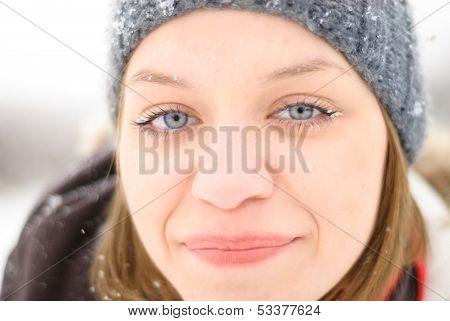 Girl's Face In Snow