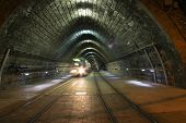 Movement Of Tram From Tunnel. Night Time poster