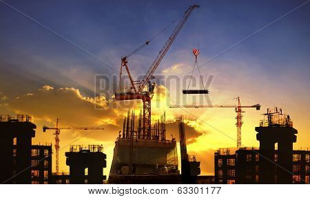 Big Crane And Building Construction Against Beautiful Dusky Sky Use For Construction Industry And En