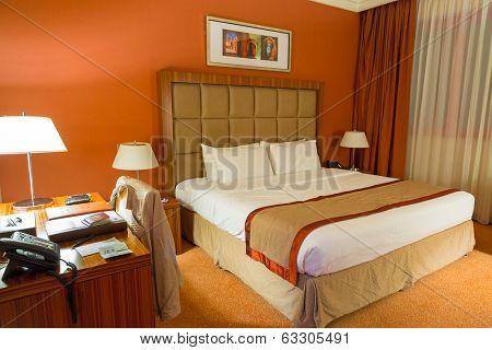 ABU DHABI, UAE - MARCH 25: Luxury bedroom of City Seasons Al Hamra Hotel in Abu Dhabi on 25 March 2014, UAE. City Seasons group owns 6 hotels in Abu Dhabi, Al Ain, Dubai and Muscat with 1300 rooms.