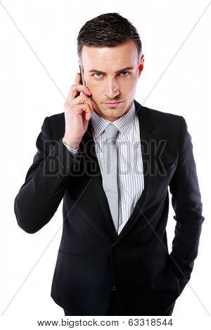 Business man talking on his mobile phone over white background