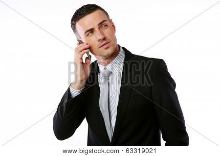 Confident businessman talking on the phone over white background