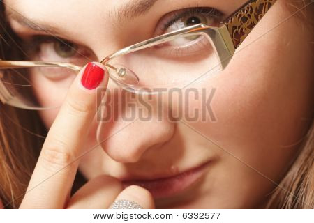 Young Woman Face In Eyeglasses