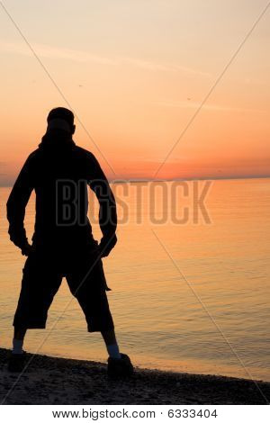 Silhouette of a Man by the Shore
