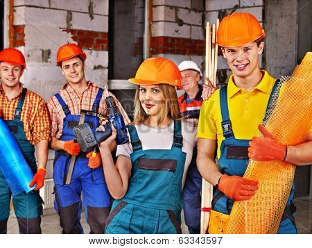 Happy group people in builder uniform. poster
