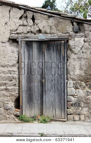 Weathered Door in a Stone Wall