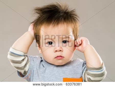 Baby boy feeling confused