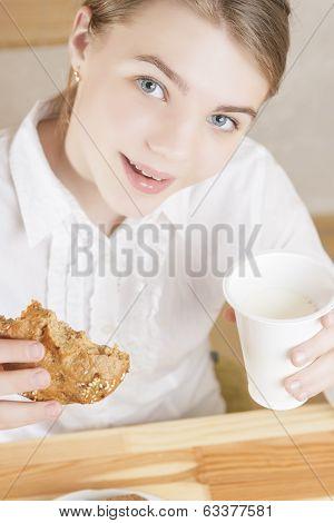 Portrait Of Teenager Girl Eating Morning Breakfast