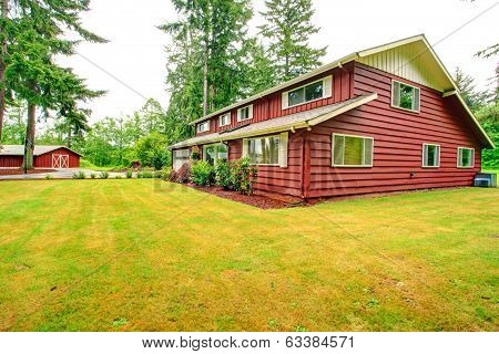 Red Clapboard Siding House With Garage