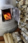 old stove flame and birch firewood vertical poster