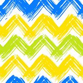 Vector seamless chevron pattern hand painted with bold brushstrokes in bright multiple colors can be used for print, wallpaper, fall summer fashion, and gift wrapping paper poster