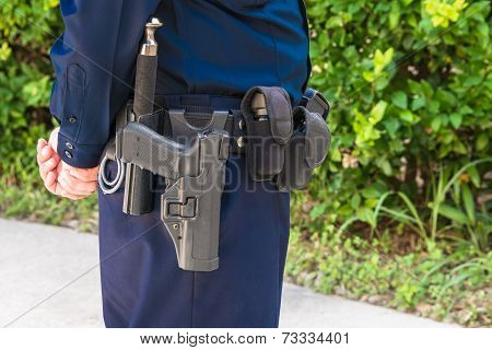 Law Officer Standing Guard with Weapon And batton on Belt