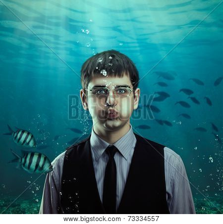 Underwater scene of a businessman with fishes