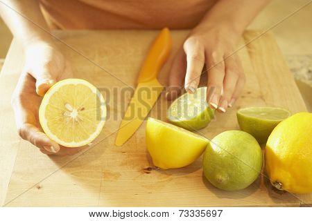 Asian woman cutting lemons
