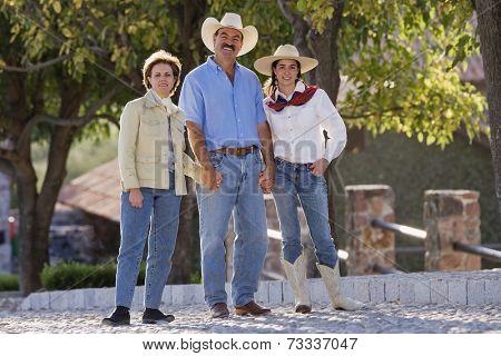Hispanic family holding hands