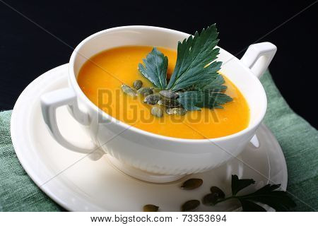 Pumpkin Soup In White Bowl On Black Background