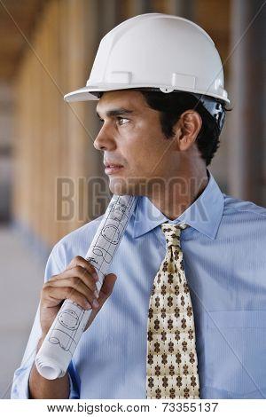 Hispanic businessman wearing hard hat