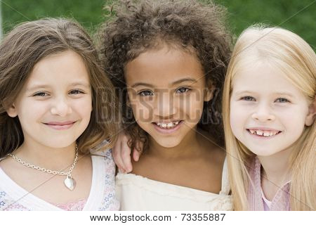 Close up of multi-ethnic girls smiling