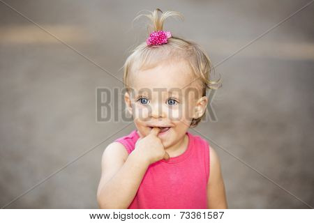 Cute little girl with a pink hair tie