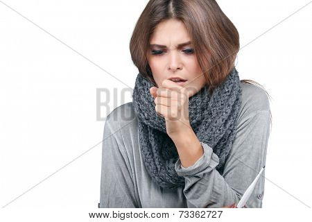 ill woman taking her temperature wile feeling sick and with fever, isolated on a white background