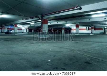 Dirty Underground Parking Garage With One Car