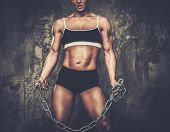 Muscular bodybuilder woman holding chains poster