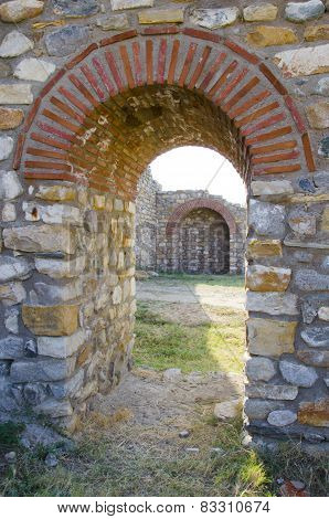 Old arched stone passage in an ancient town c