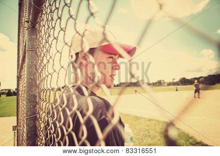 Teen boy on sidelines at baseball practice. Instagram effect.