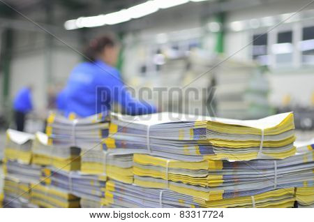 Printed material packets in print shop