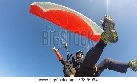 Paragliders against blue sky