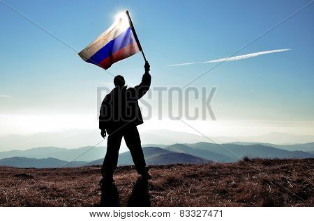 Man holding and waving Russian flag