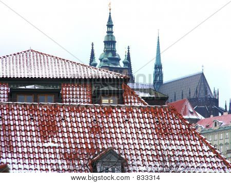 The Prague lock and snow roofs of old city