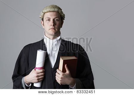 Studio Portrait Of Lawyer Holding Brief And Book